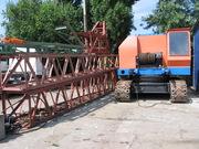 Дизель - электрический гусеничный кран МКГ 25 БР
