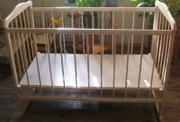 Новая детская кроватка с колесами,  качалкой,  2 уровня дна